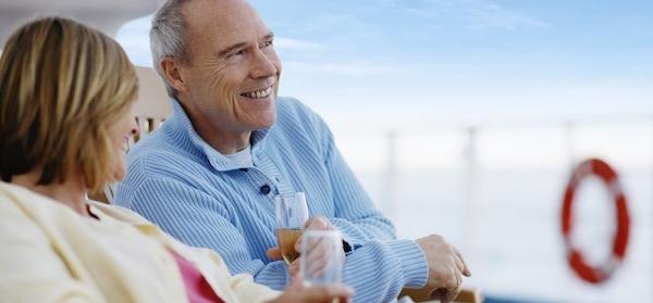 Couple enjoying drinks on cruise ship deck